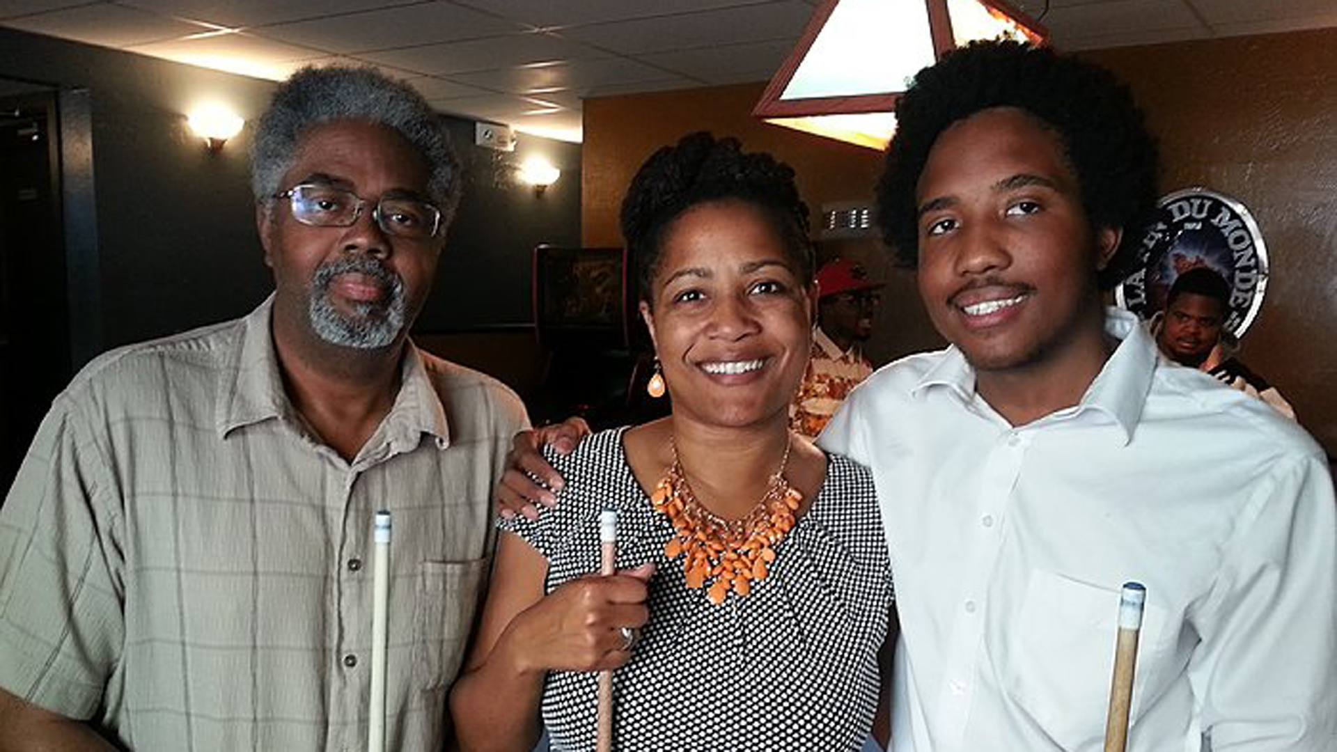 Victor McElhaney (right) Celebrating his 21st Birthday with his mom Councilmember Lynette McElhaney (center) and father Clarence McElhaney (left) at Luca's Taproom in Oakland. (Credit: City of Oakland)