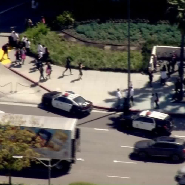 Shoppers leave Westfield Century City after reports of a man with a gun at the mall on March 15, 2019. (Credit: KTLA)