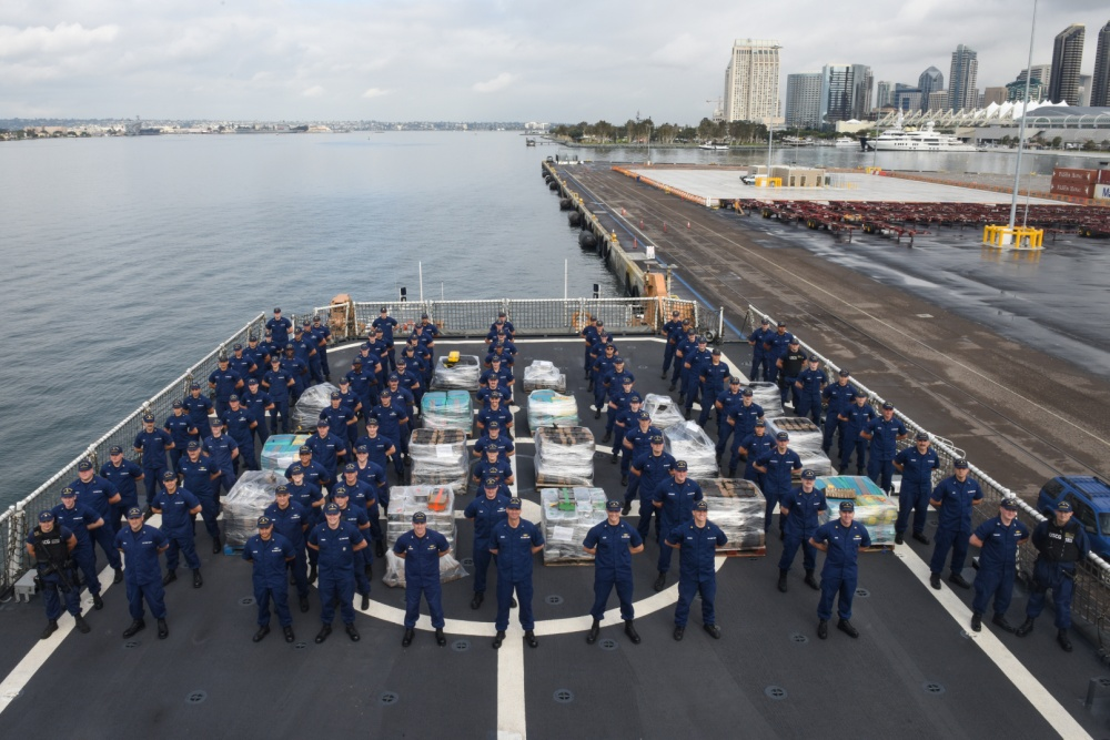The crew of the Coast Guard Cutter Waesche poses with pallets holding more than 7.1 tons of contraband Friday at Tenth Avenue Marine Terminal in San Diego April 5, 2019. (Credit: U.S. Coast Guard/ Petty Officer 2nd Class Joel Guzman)
