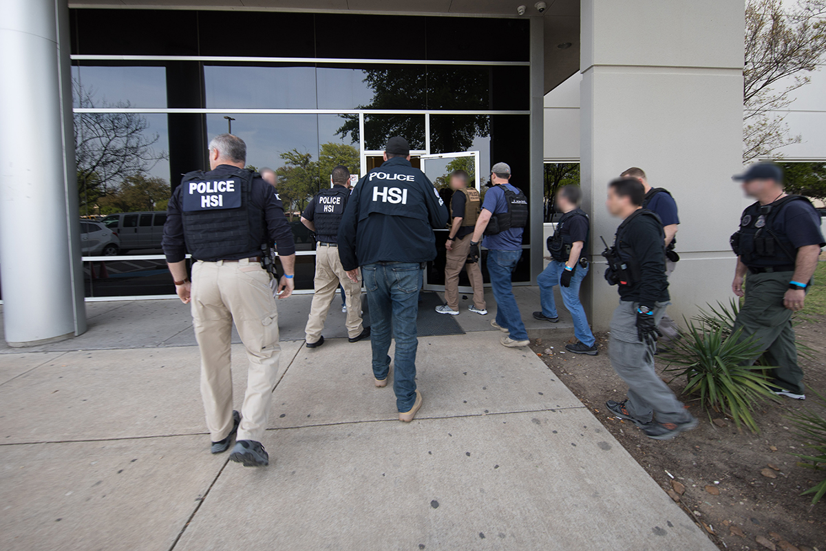 Special agents with U.S. Immigration and Customs Enforcement serve search warrants at CVE Technology Group in Allen, Texas, on April 4, 2019, in an image released by the agency.
