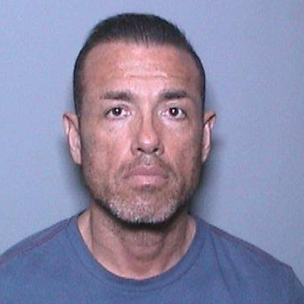 Carlos Juarez, 44, is seen in an undated booking photo provided by the Irvine Police Department.
