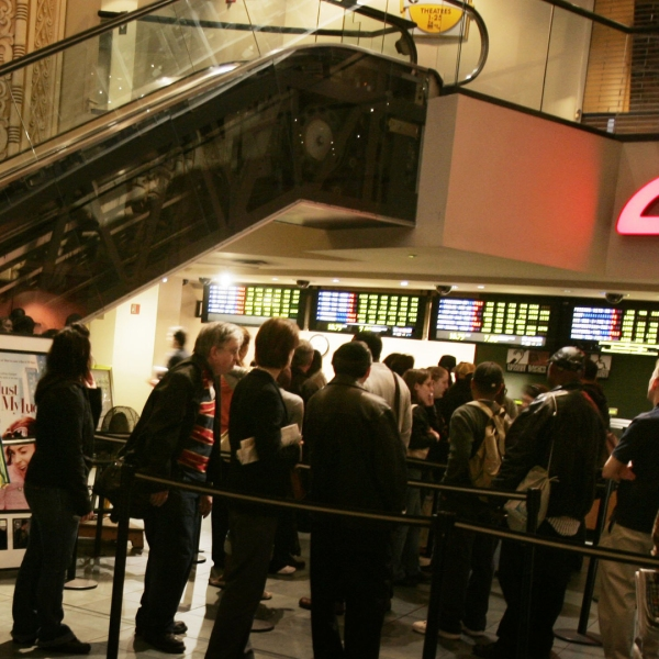 In this file photo, fans wait in line to buy tickets at an AMC theater in New York. (Credit: Chris Hondros/Getty Images)