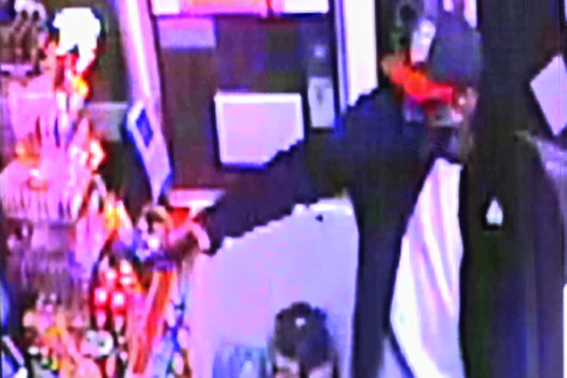 A surveillance image shows an armed robber inside a Huntington Beach Arco food mart on April 1, 2019. (Credit: OnScene.TV)
