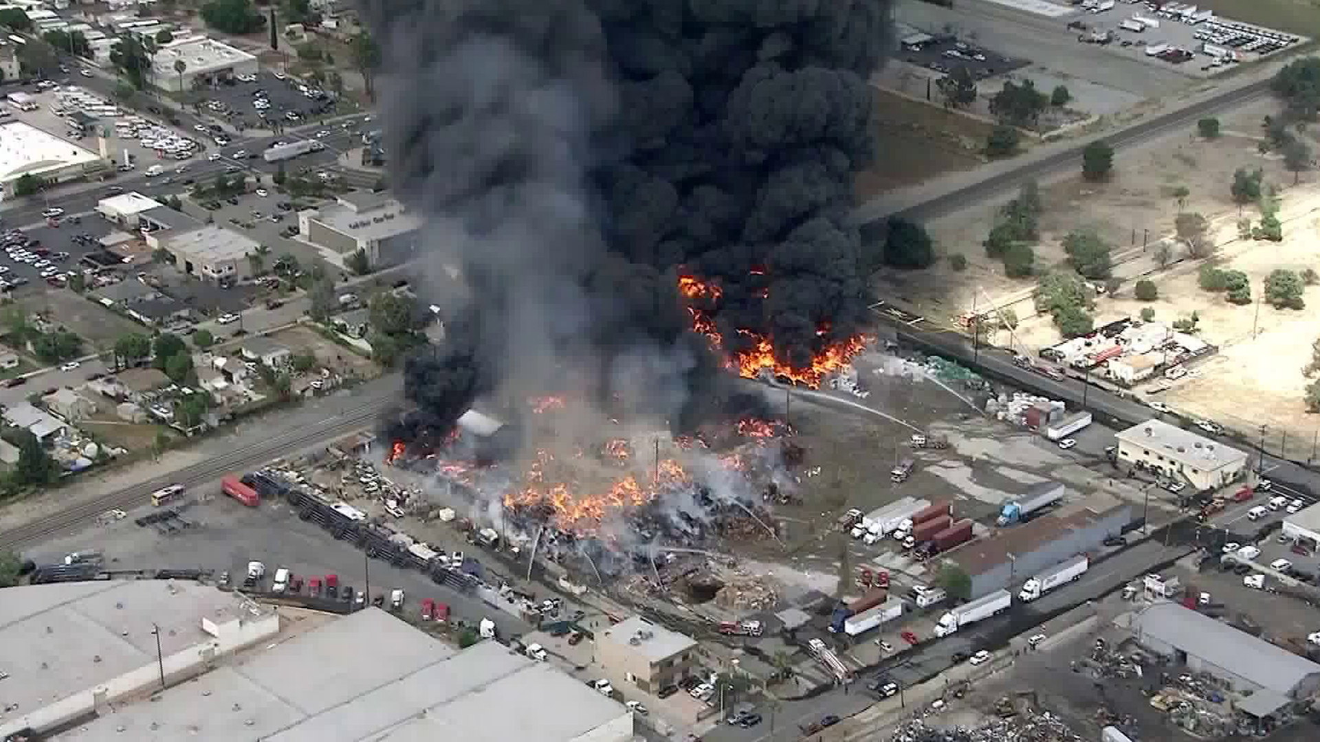 Firefighters battle a blaze at a recycling facility in Ontario on April 30, 2019. (Credit: KTLA)