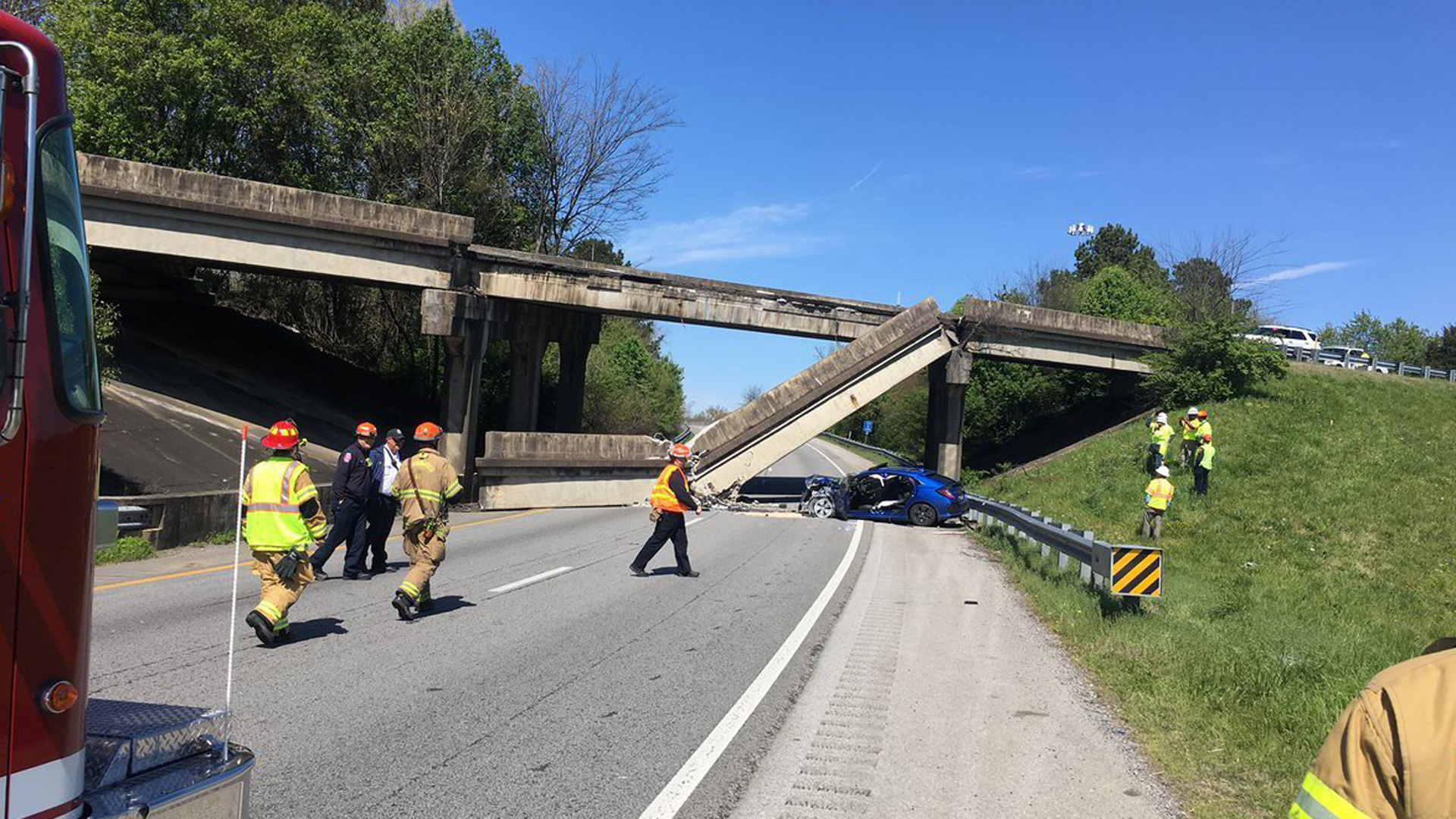 A concrete railing fell from a bridge onto the roadway below at the Interstate 75 North and Interstate 24 West split in Chattanooga, Tennessee, on Monday. (Credit: Chattanooga Fire Department)