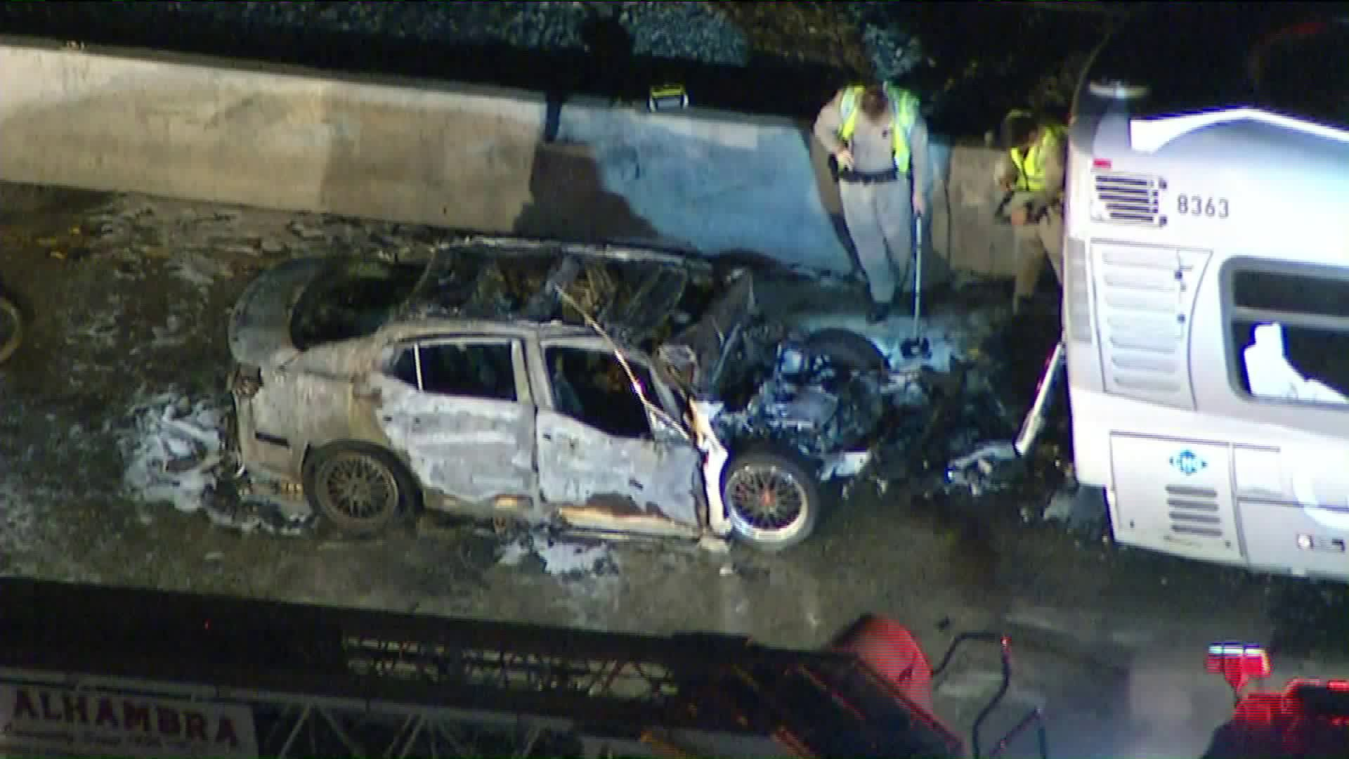 The vehicle that caught fire in a crash on the 10 Freeway in Alhambra on April 30, 2019. (Credit: KTLA)