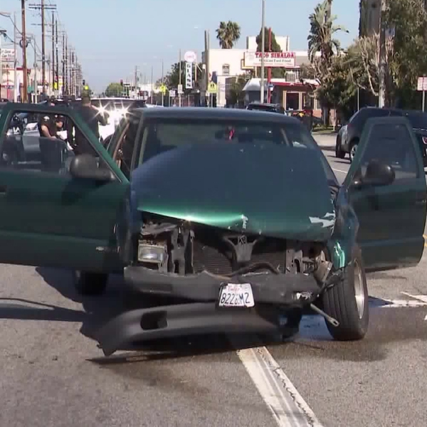 The suspect's green pickup truck is seen after a it-and-run collision in Wilmington on April 17, 2019. (Credit: KTLA)