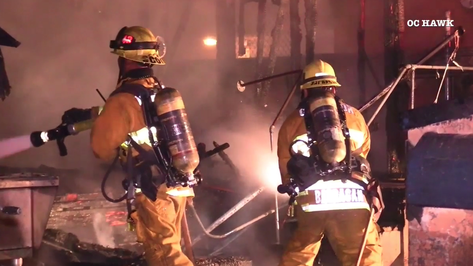 Compton firefighters work to extinguish flames of a home on fire on April 2, 2019. (Credit: OC Hawk)