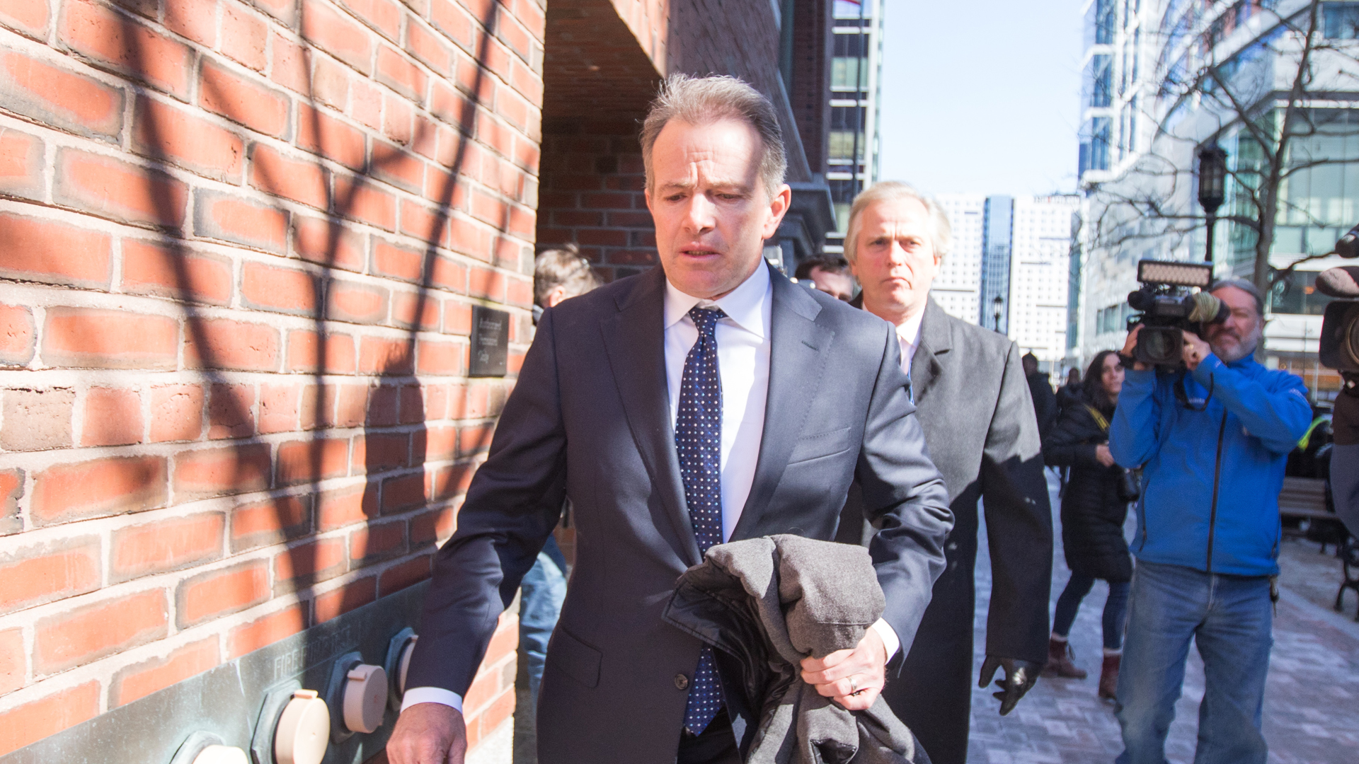 Gordon Ernst, former head coach of the men's and women's tennis teams at Georgetown University leaves following his arraignment at Boston Federal Court on March 25, 2019 in Boston. (Credit: Eisen/Getty Images)