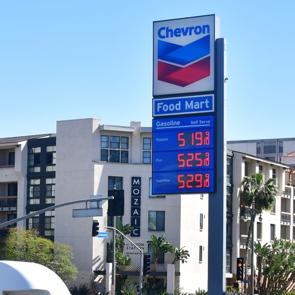 A vehicle enters a gas station charging over $5 a gallon for Regular, Plus and Supreme gas in Los Angeles on April 9, 2019. (Credit: FREDERIC J. BROWN/AFP/Getty Images)