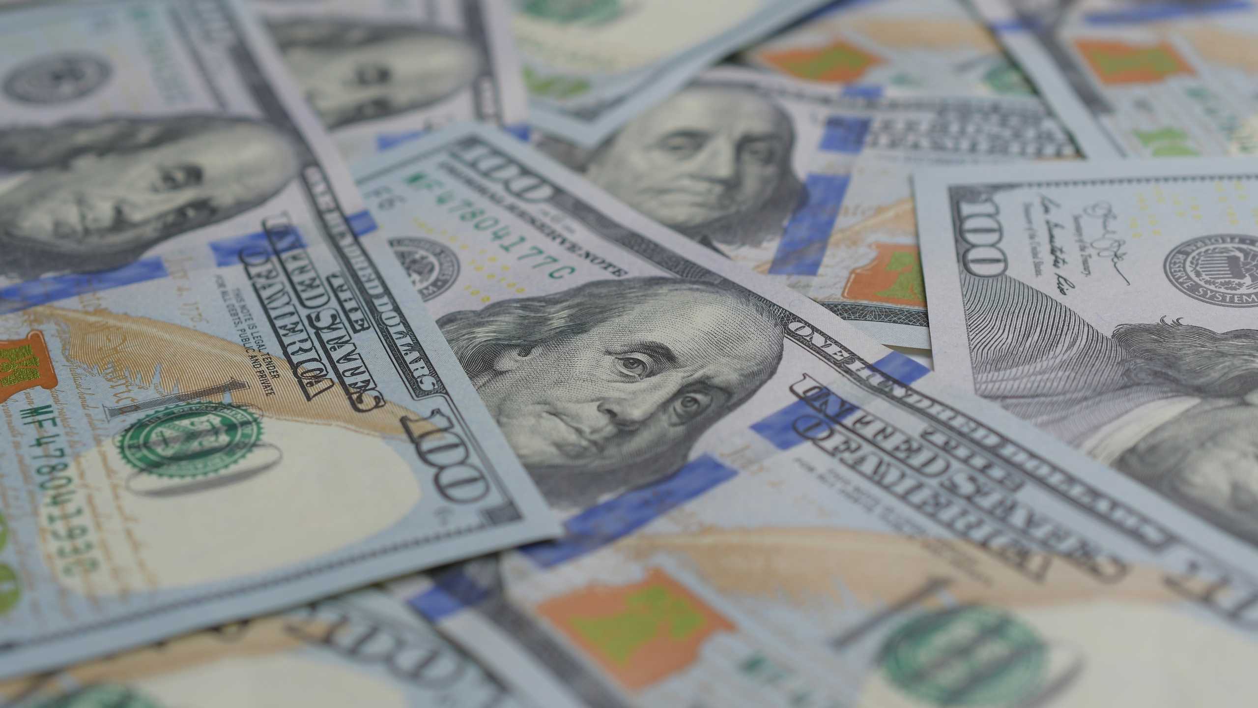 $100 bills are seen in a file photo. (Credit: Getty Images)