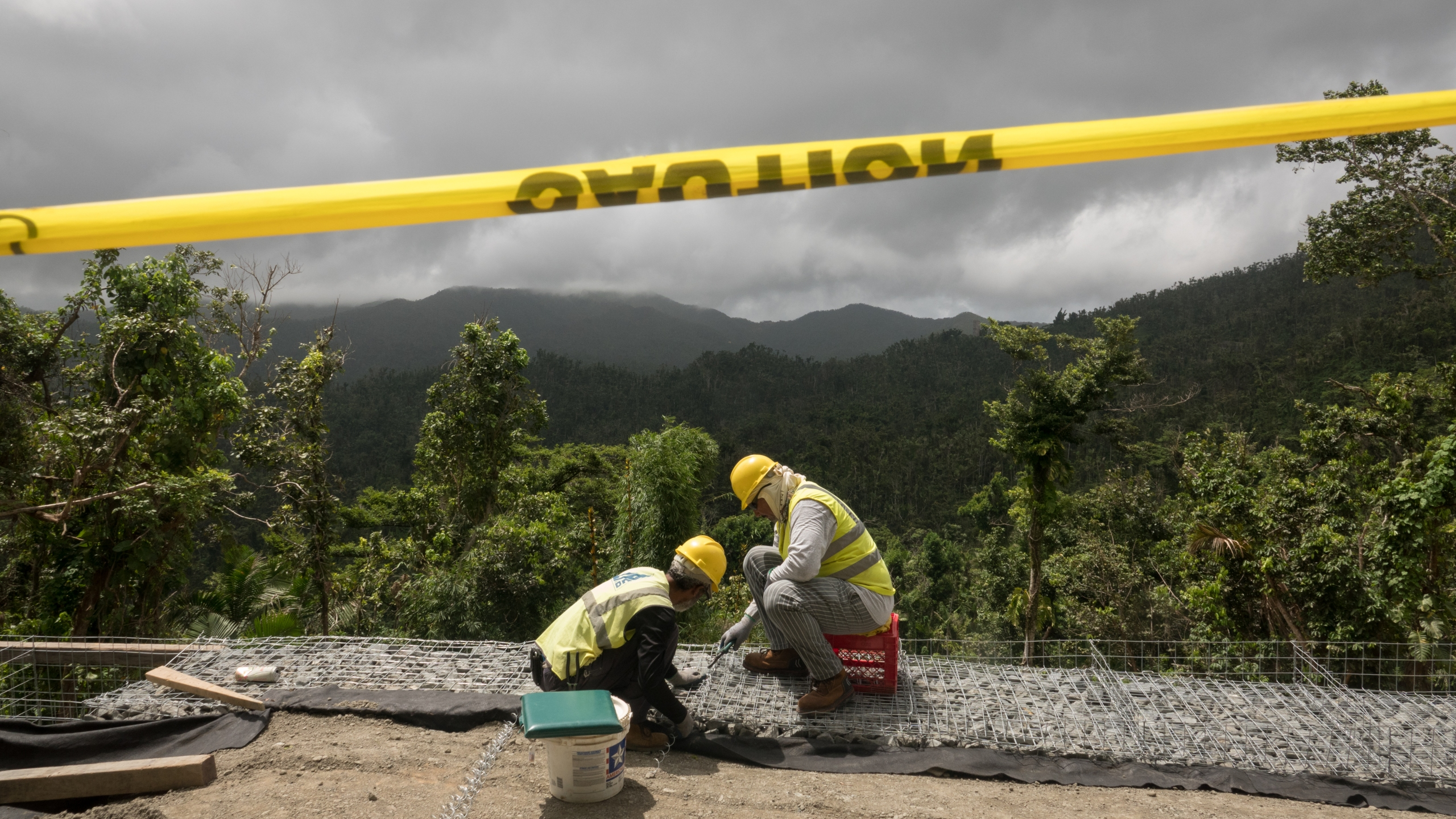 Crews work to repair the road to El Yunque Rain Forest, parts of which remain off-limits a year after Hurricane Maria hit, on Sept. 19, 2018. (Credit: Angel Valentin / Getty Images)