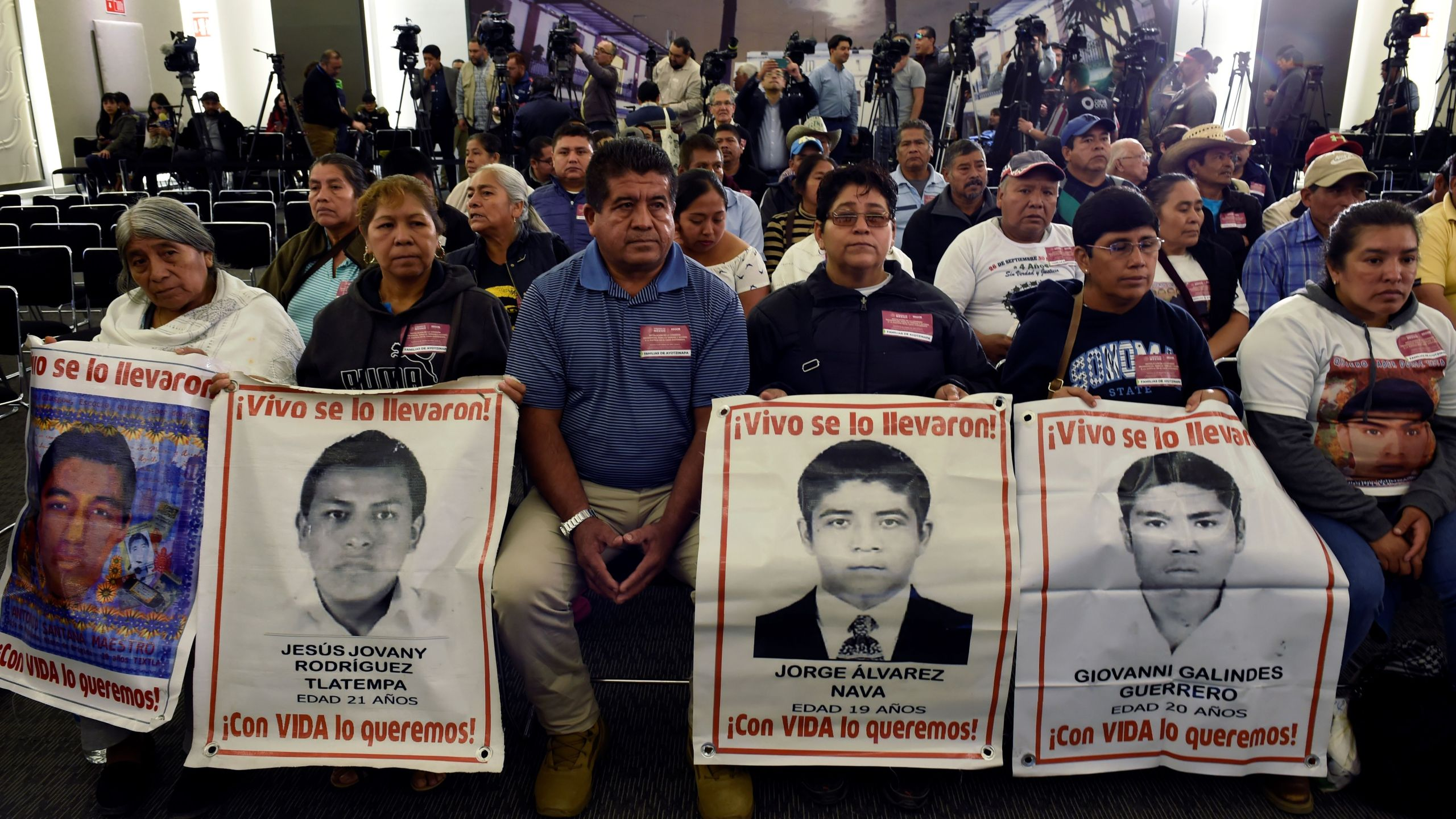Relatives of some of the 43 students of the teaching training school in Ayotzinapa who went missing in 2014, attend the installation of a truth commission on the Ayotzinapa case at the Interior Ministry in Mexico City on January 15, 2019. (Credit: ALFREDO ESTRELLA/AFP/Getty Images)