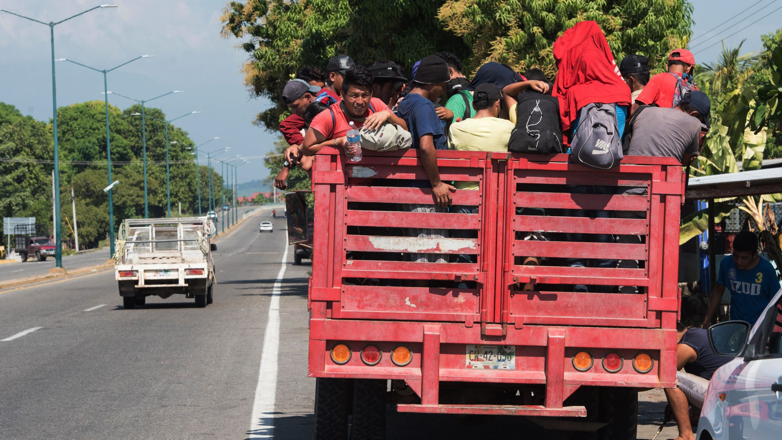 Central American migrants heading to the United States with a second caravan, are seen in Huixtla, Chiapas state after crossing the border from Guatemala, in southern Mexico on Jan. 19, 2019. (Alejandro Melendez/AFP/Getty Images)