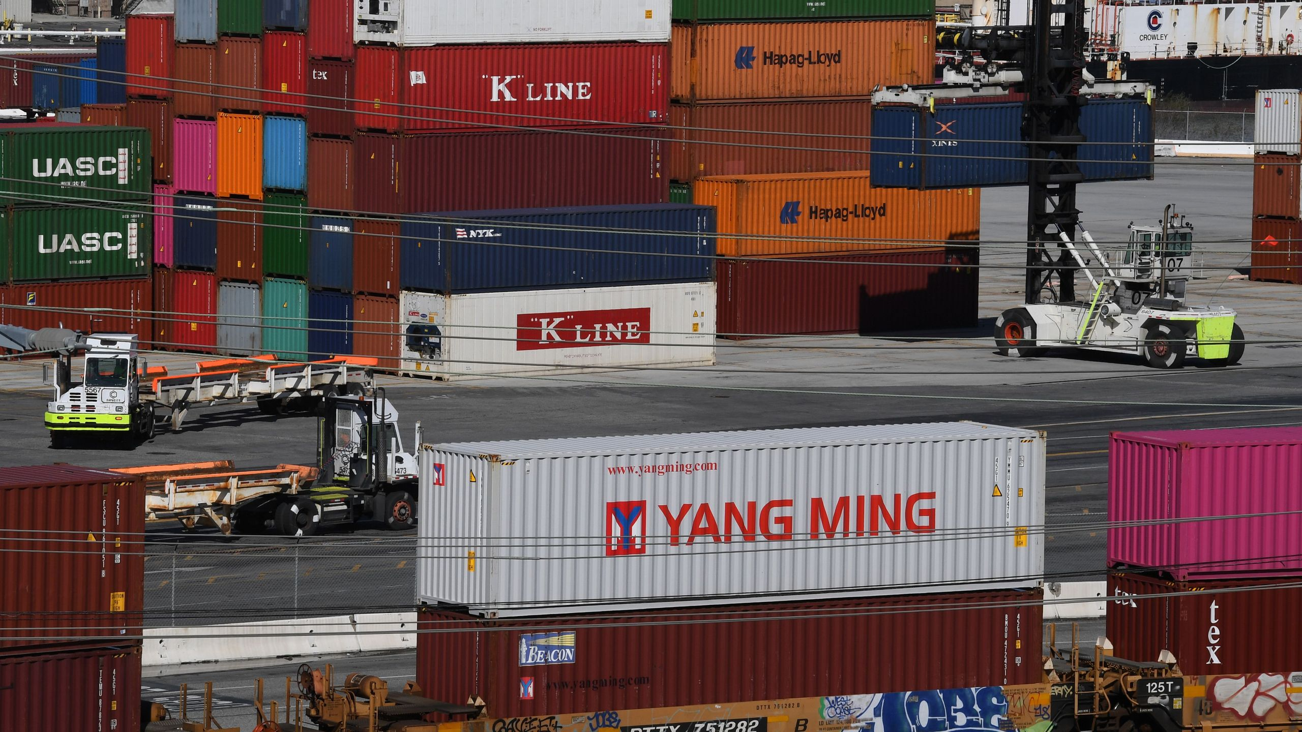 Shipping containers from China and other nations are unloaded at the Long Beach Port in Los Angeles, California on February 16, 2019. (Credit: MARK RALSTON/AFP/Getty Images)