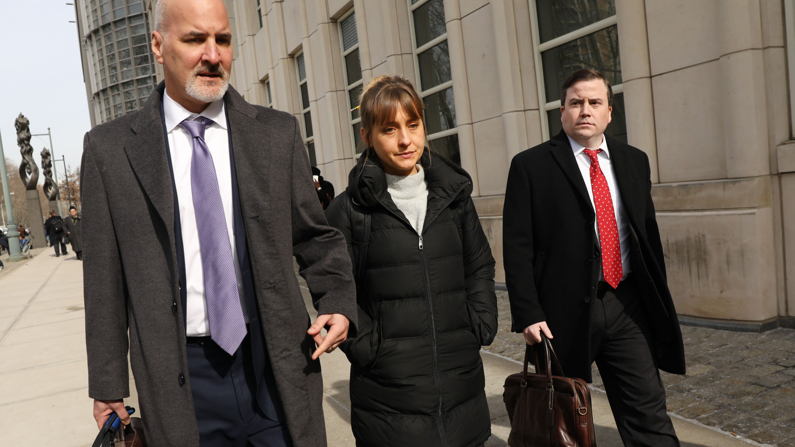 Actress Allison Mack leaves the Brooklyn Federal Courthouse with her lawyers after a court appearance surrounding the alleged sex cult NXIVM on Feb. 6, 2019. (Credit: Spencer Platt / Getty Images)