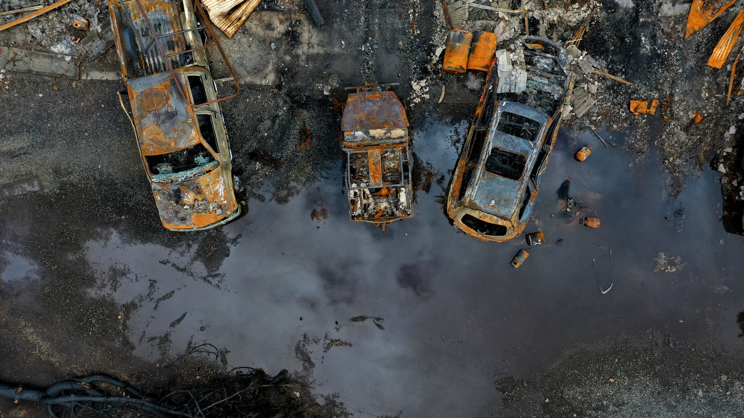 Cars destroyed by the Camp Fire in Paradise are seen in an aerial view on Feb. 11, 2019, three months after the deadly and destructive blaze. (Credit: Justin Sullivan / Getty Images)