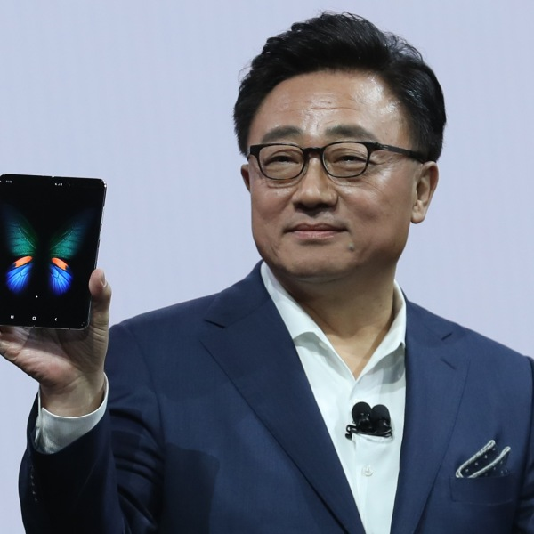 Samsung's Mobile Division President and CEO DJ Koh holds the new Samsung Galaxy Fold smartphone during the Samsung Unpacked event on February 20, 2019 in San Francisco. (Credit: Justin Sullivan/Getty Images)