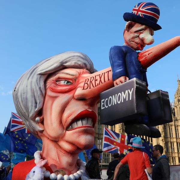Anti-Brexit activists demonstrate with a model of Theresa May outside the Houses of Parliament in London April 1, 2019. (Credit: Isabel Infantes / AFP / Getty Images)