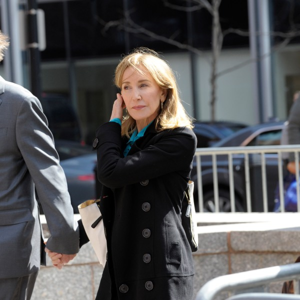 Actress Felicity Huffman enters the court to appear before Judge M. Page Kelley to face charge for allegedly conspiring to commit mail fraud and other charges in the college admissions scandal at the John Joseph Moakley United States Courthouse in Boston, Mass. on April 3, 2019. (Credit: Joseph Prezioso / AFP /Getty Images)