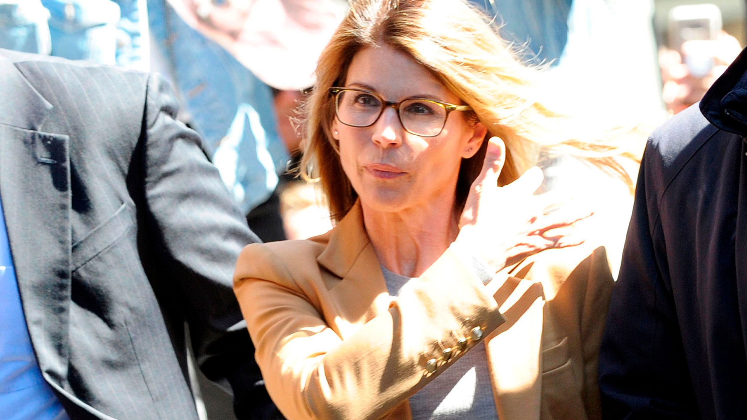 Actress Lori Loughlin arrives at the court to appear before Judge M. Page Kelley to face charge for allegedly conspiring to commit mail fraud and other charges in the college admissions scandal at the John Joseph Moakley United States Courthouse in Boston, Mass. on April 3, 2019. (Credit: JOSEPH PREZIOSO/AFP/Getty Images)