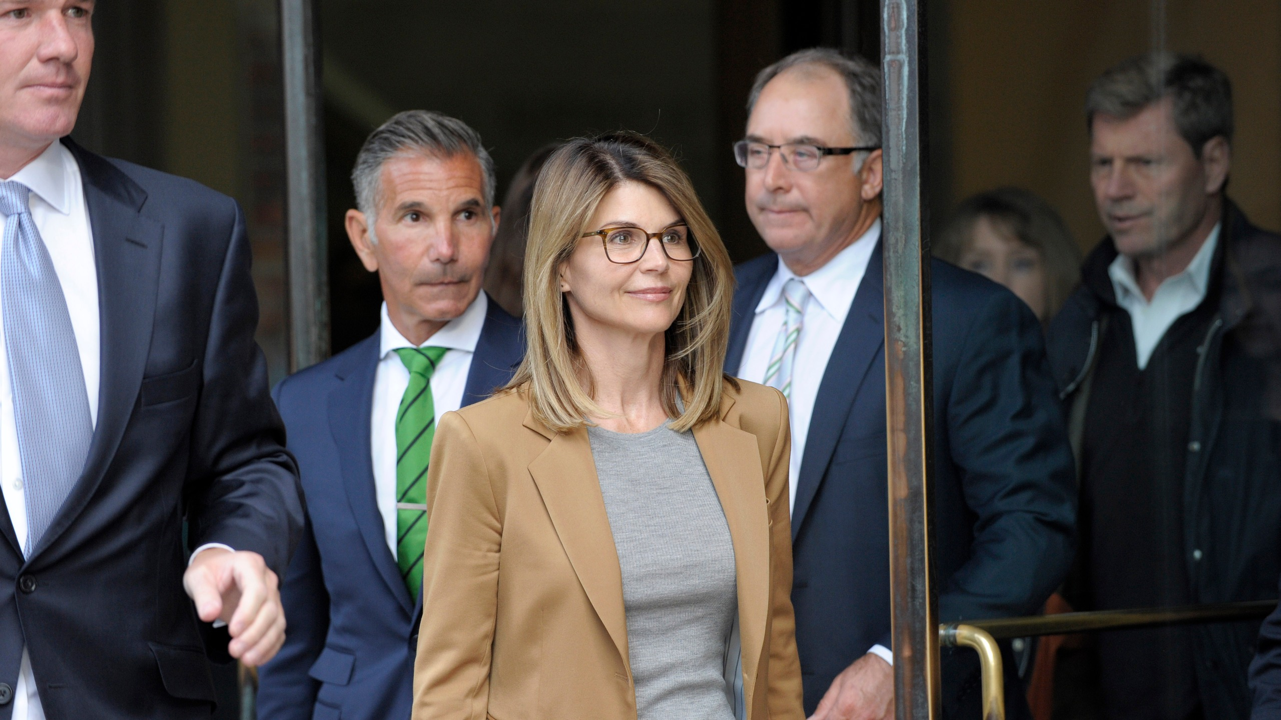 Actress Lori Loughlin exits the John Joseph Moakley Courthouse in Boston on April 3, 2019. (Credit: JOSEPH PREZIOSO/AFP/Getty Images)