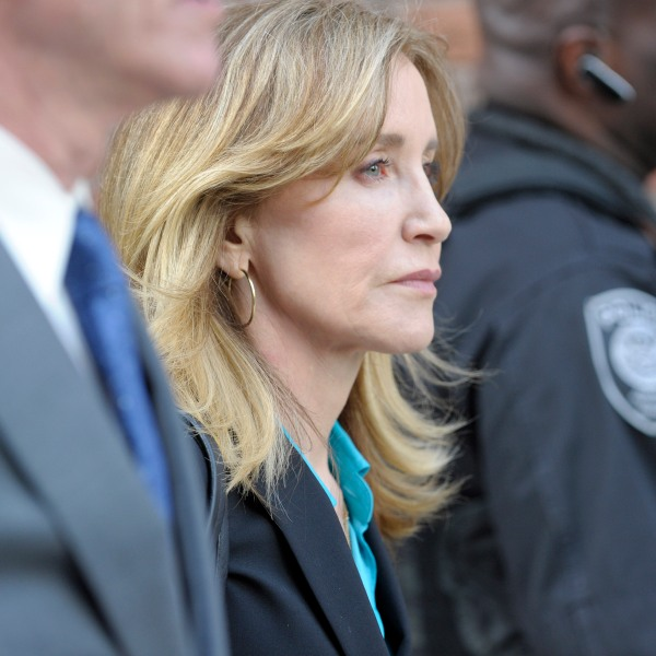 Actress Felicity Huffman exits the John Joseph Moakley United States Courthouse in Boston on April 3, 2019. (Credit: JOSEPH PREZIOSO/AFP/Getty Images)