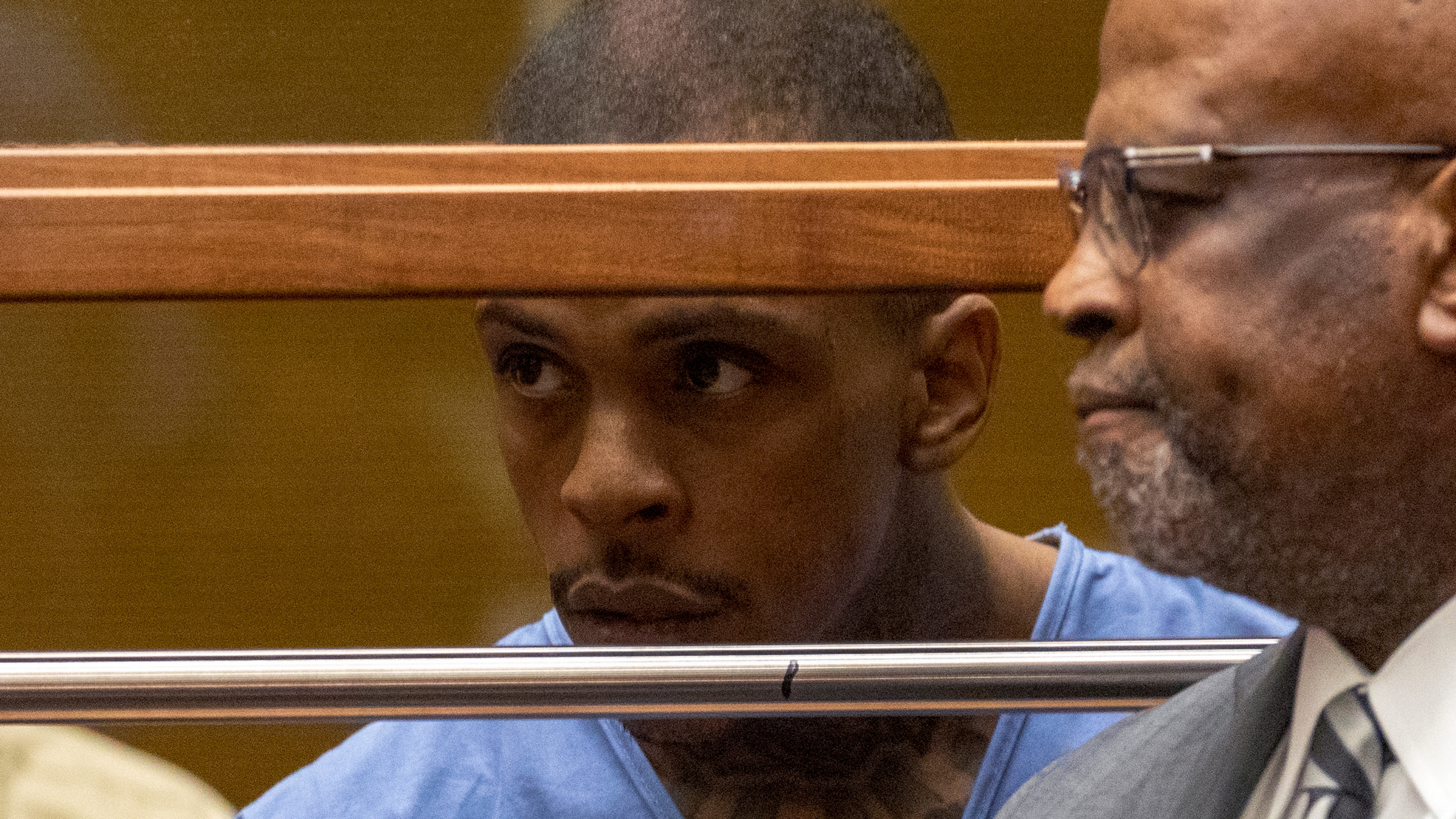 Eric Ronald Holder Jr., 29, who is accused of killing of rapper Nipsey Hussle, appears for arraignment in Los Angeles with then-attorney Christopher Darden on April 4, 2019. (Credit: Patrick Fallon / Getty Images)
