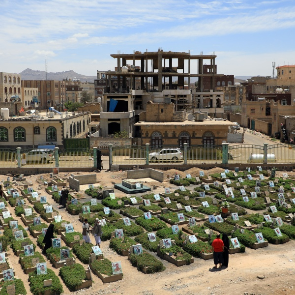 Yemenis visit a cemetery in the capital Sanaa on April 5, 2019. The World Health Organization estimates nearly 10,000 Yemenis have been killed since 2015, when Saudi Arabia and its allies intervened to prevent the defeat of the government in the face of a rebel offensive. (Credit: Mohammed Huwais / AFP / Getty Images)