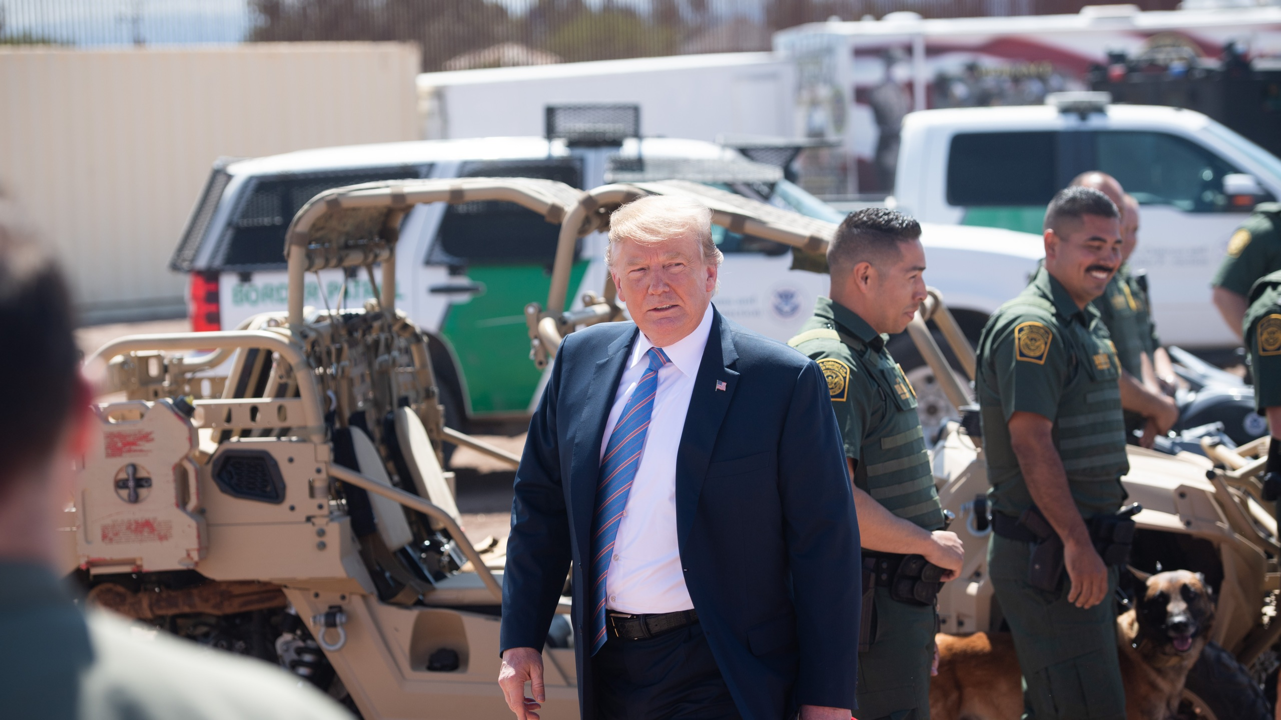 President Donald Trump speaks with members of the U.S. Border Patrol as he tours the border wall between the U.S. and Mexico in Calexico on April 5, 2019. (Credit: Saul Loeb / AFP / Getty Images)