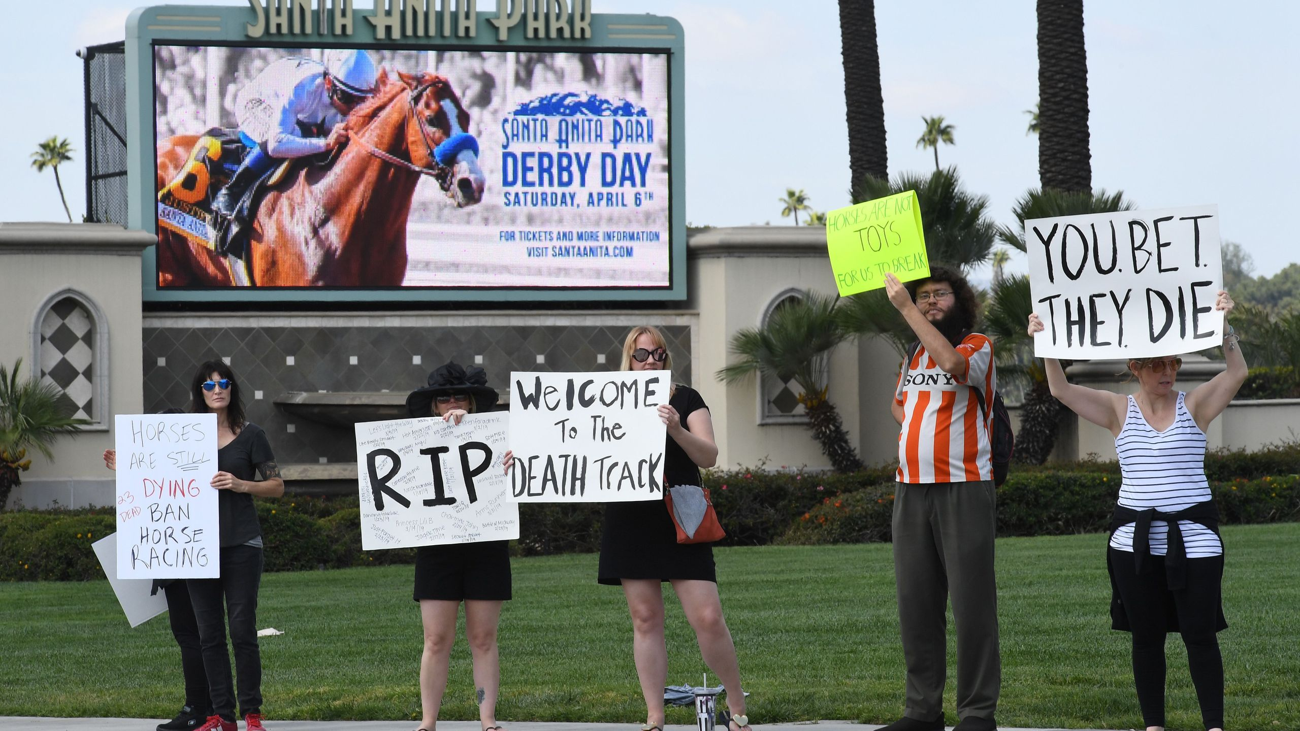Animal-rights advocates protest the deaths of 23 racehorses since Dec. 26 at Santa Anita Park in Arcadia on April 6, 2019. (Credit: Mark Ralston / AFP / Getty Images)