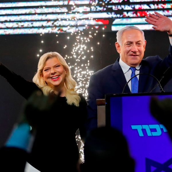 Israeli Prime Minister Benjamin Netanyahu, accompanied by his wife Sara, greets supporters on election night at his Likud Party headquarters in the Israeli coastal city of Tel Aviv early on April 10, 2019. (Credit: THOMAS COEX/AFP/Getty Images)