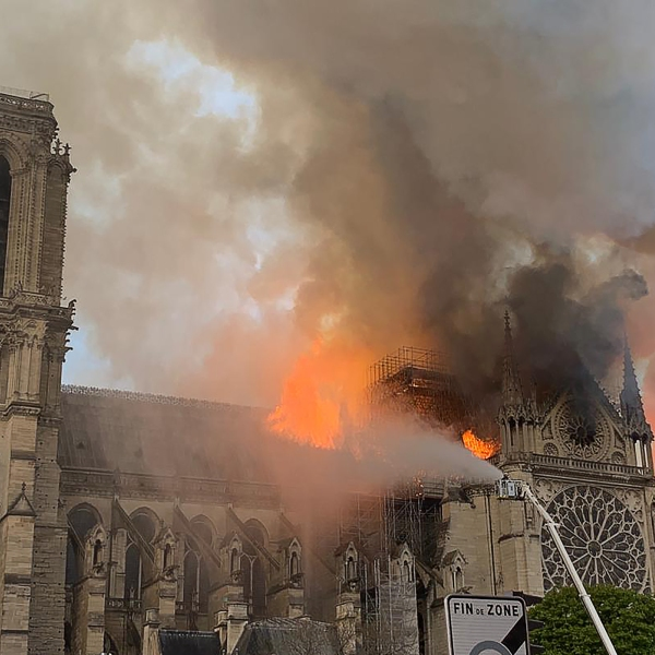 Flames and smoke are seen billowing from the roof at Notre-Dame Cathedral in Paris on April 15, 2019. (Credit: PATRICK ANIDJAR/AFP/Getty Images)