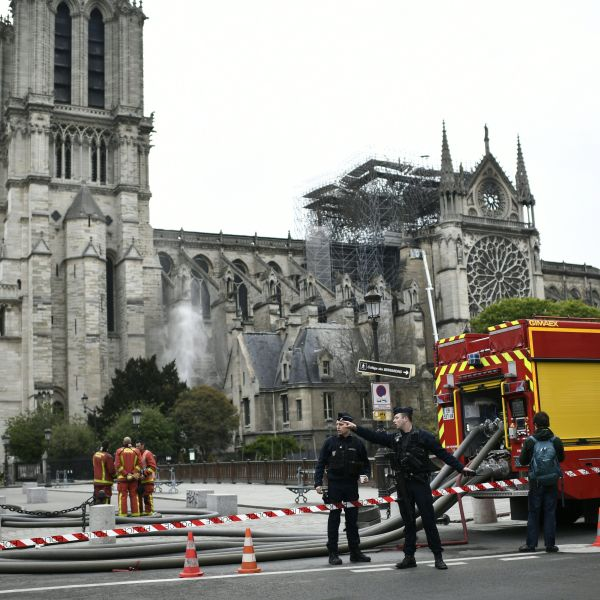Firefighters continue to secure Notre-Dame Cathedral in Paris on April 16, 2019, in the aftermath of a fire that caused its spire to crash to the ground. (Credit: STEPHANE DE SAKUTIN/AFP/Getty Images)