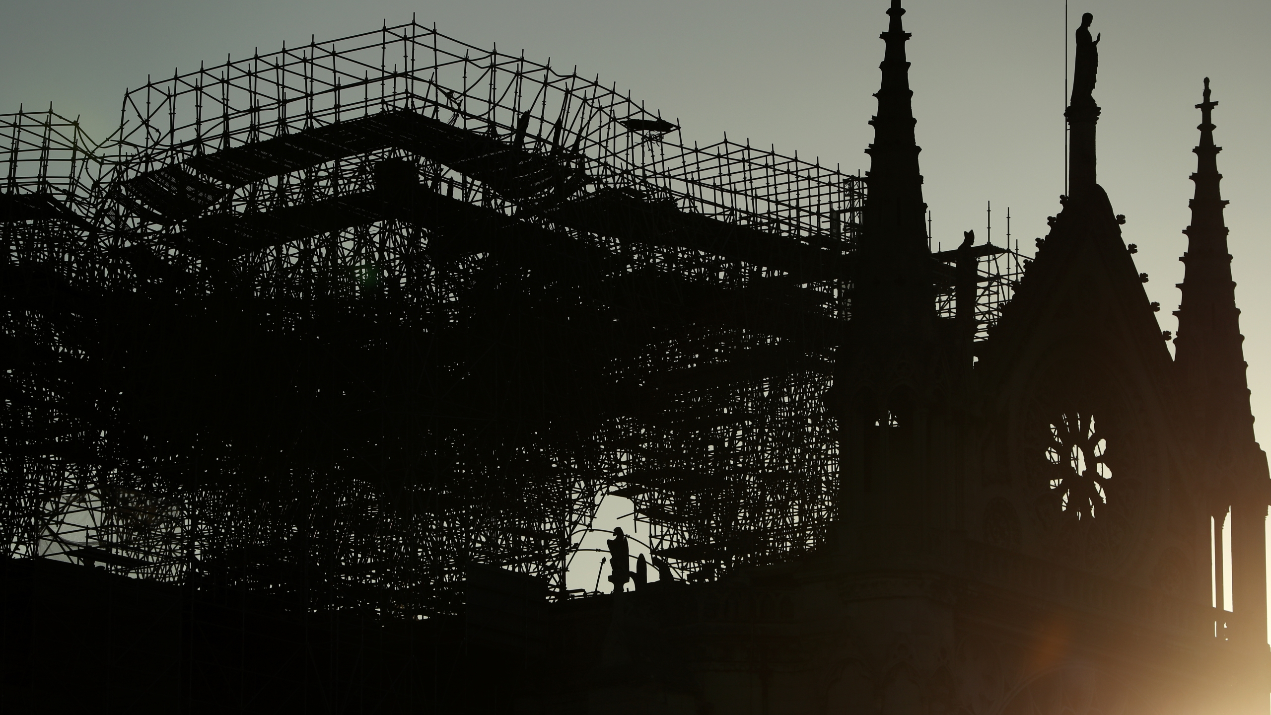 A silhouette of Notre-Dame Cathedral is seen at sunrise following a major fire on Monday on April 17, 2019 in Paris, France. (Credit: Dan Kitwood/Getty Images)