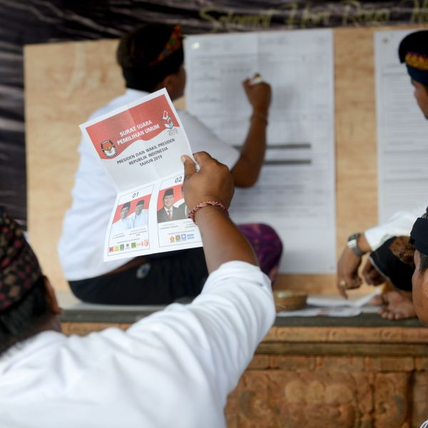 Officials count ballots at a polling center after the polls closed for Indonesia's general election in Kuta on the island of Bali on April 17, 2019.(Credit: Sonny Tumbelaka/AFP/Getty Images)
