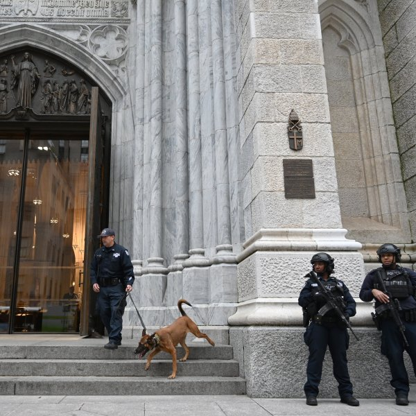 Members of the New York Police Department (NYPD) gather outside St. Patrick's Cathedral on 5th Avenue April 18, 2019, the morning after a man was arrested after trying to enter the Cathedral with gas cans. (Credit: TIMOTHY A. CLARY/AFP/Getty Images)