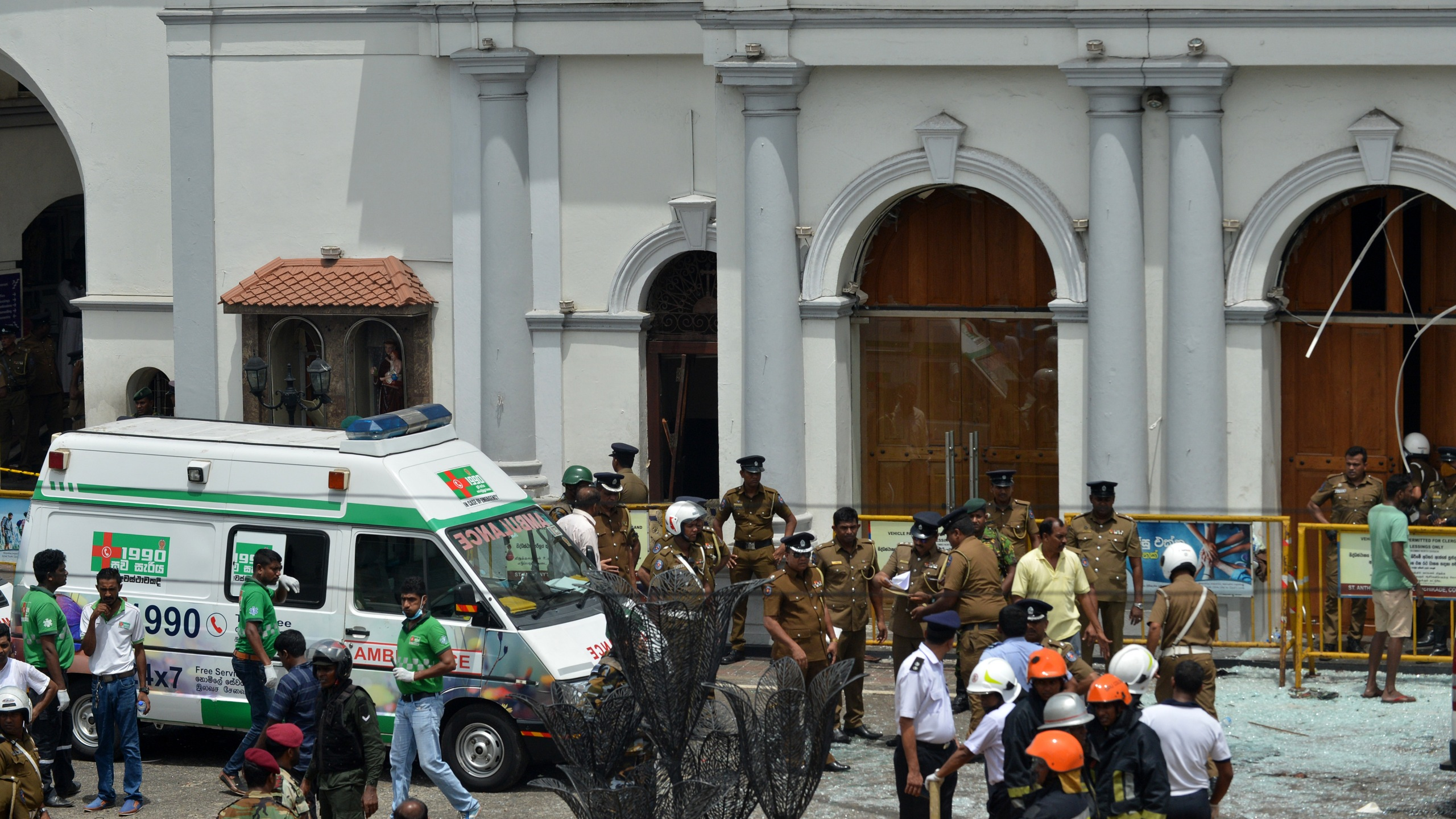 An ambulance is seen outside the church premises with gathered security personnel following a blast at the St. Anthony's Shrine in Kochchikade, Colombo on April 21, 2019. (Credit: Ishara S. Kodikara/AFP/Getty Images)