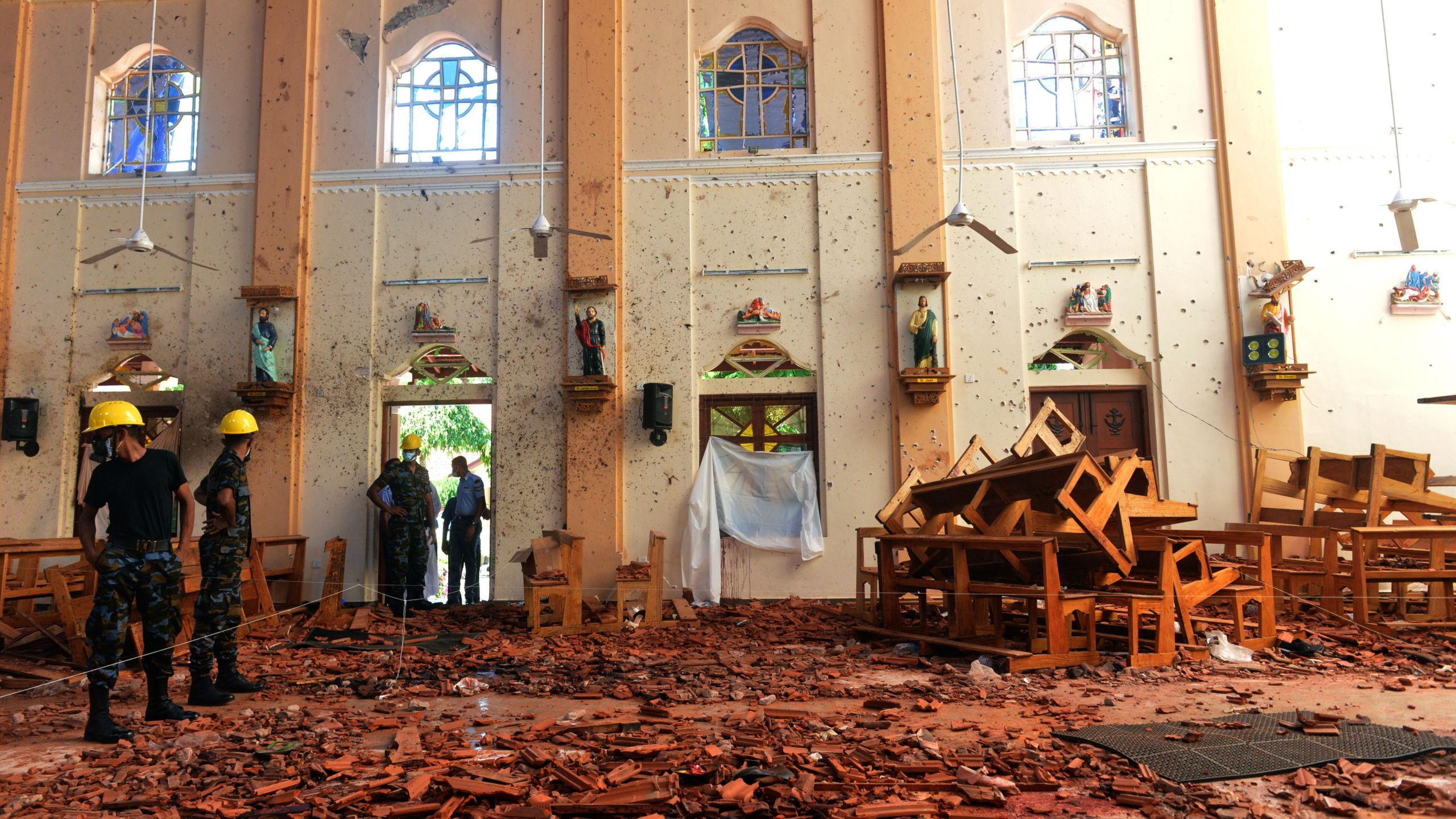 Security personnel inspect the interior of St. Sebastian's Church in Negombo on April 22, 2019. Credit: ISHARA S. KODIKARA/AFP/Getty Images)
