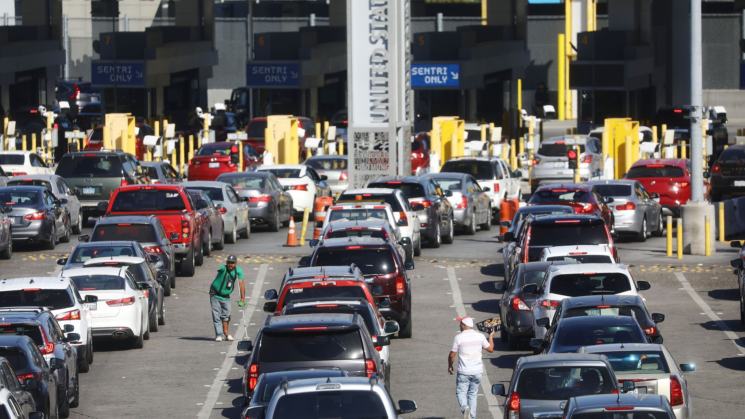Cars line up to cross into the United States at the San Ysidro Port of Entry on March 31, 2019, in Tijuana, Mexico. (Credit: Mario Tama/Getty Images)