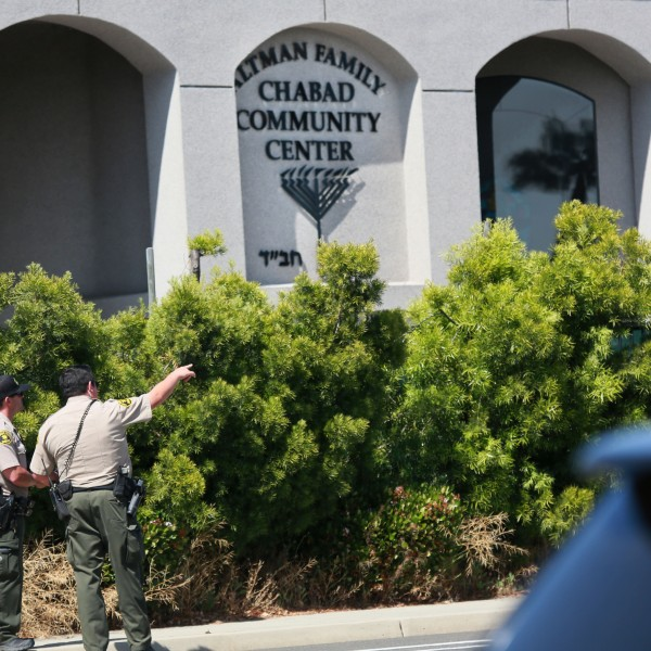 San Diego Sheriff deputies look over the Chabad of Poway Synagogue after a shooting on Saturday, April 27, 2019, in Poway. (Credit: SANDY HUFFAKER/AFP/Getty Images)