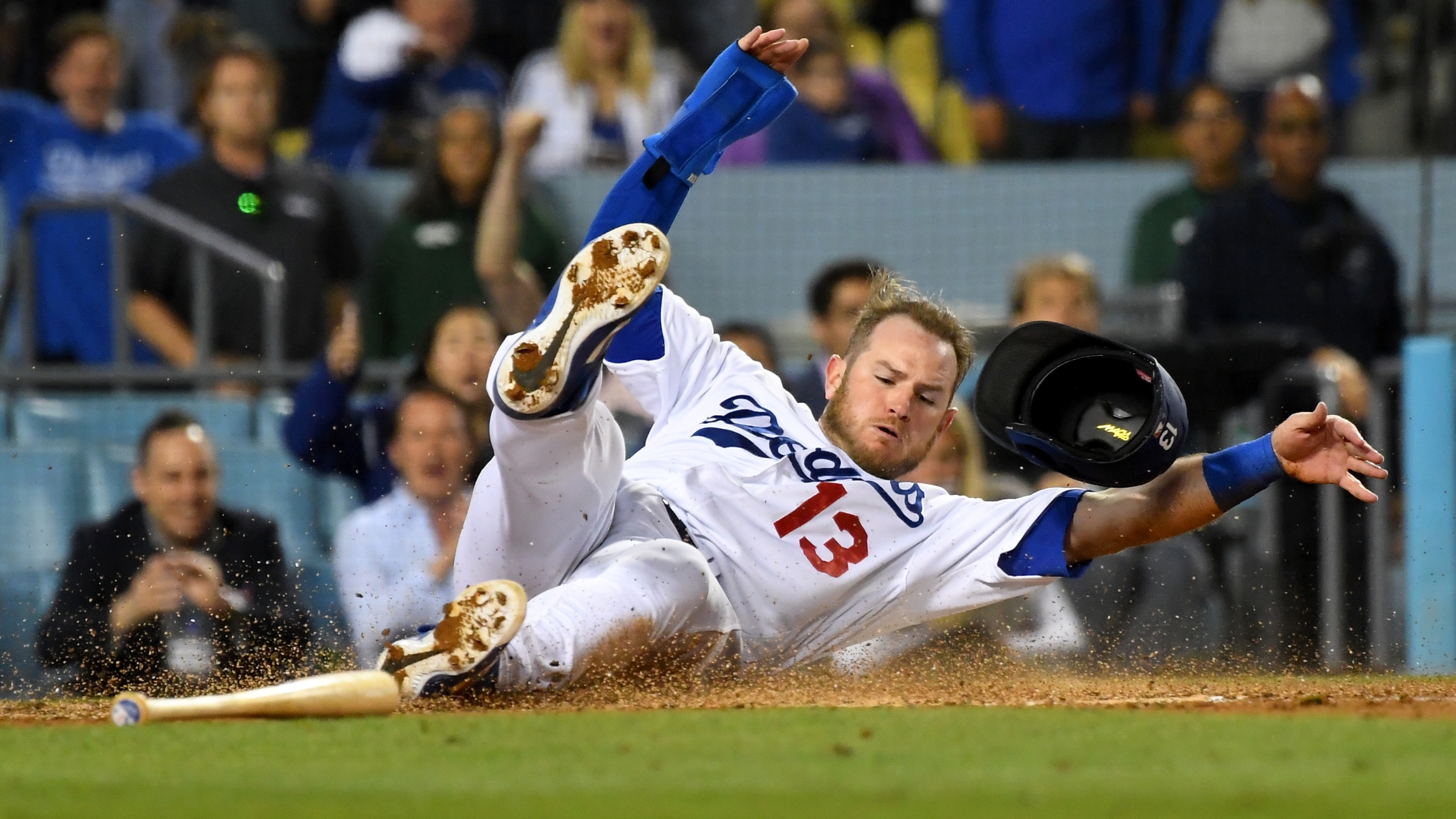 Max Muncy #13 of the Los Angeles Dodgers is safe at home as he gets past Francisco Cervelli #29 of the Pittsburgh Pirates to score a run on a sacrifice fly by Chris Taylor #3 of the Los Angeles Dodgers in the seventh inning of the game at Dodger Stadium on April 27, 2019 in Los Angeles, California. (Credit: Jayne Kamin-Oncea/Getty Images)