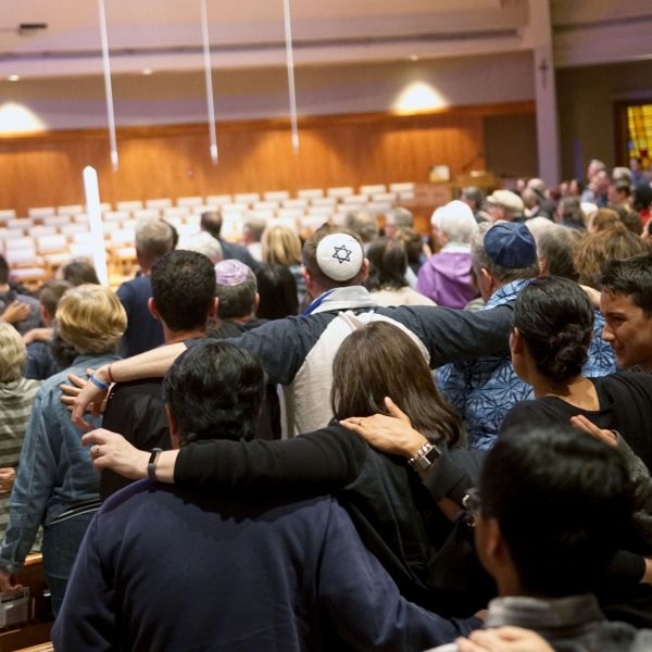 Mourners participate in a vigil for the victims of the Chabad of Poway Synagogue shooting at the Rancho Bernardo Community Presbyterian Church on April 27, 2019. (Credit: SANDY HUFFAKER/AFP/Getty Images)