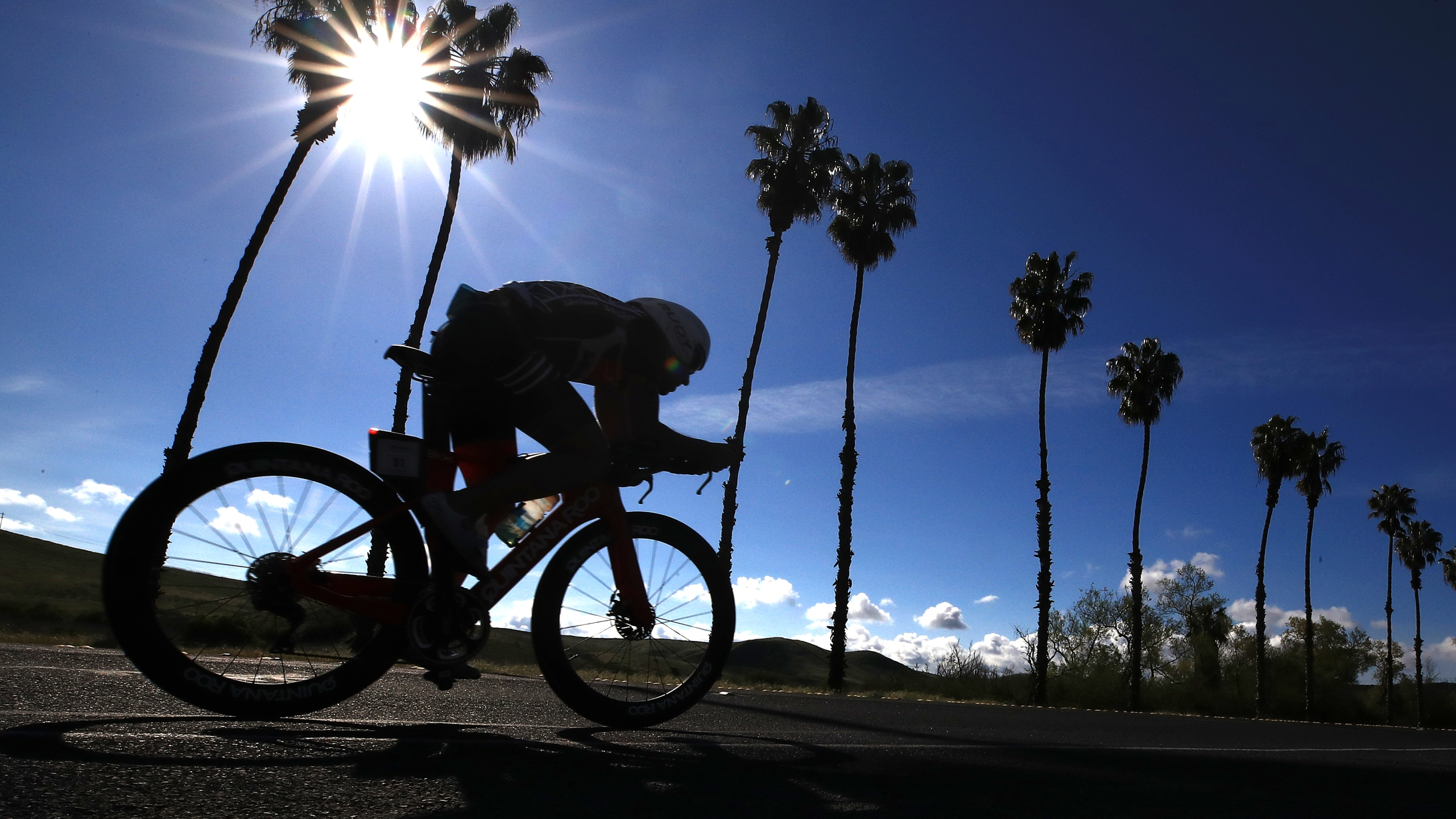 A man cycles in Oceanside on April 6, 2019. (Credit: Sean M. Haffey/Getty Images)