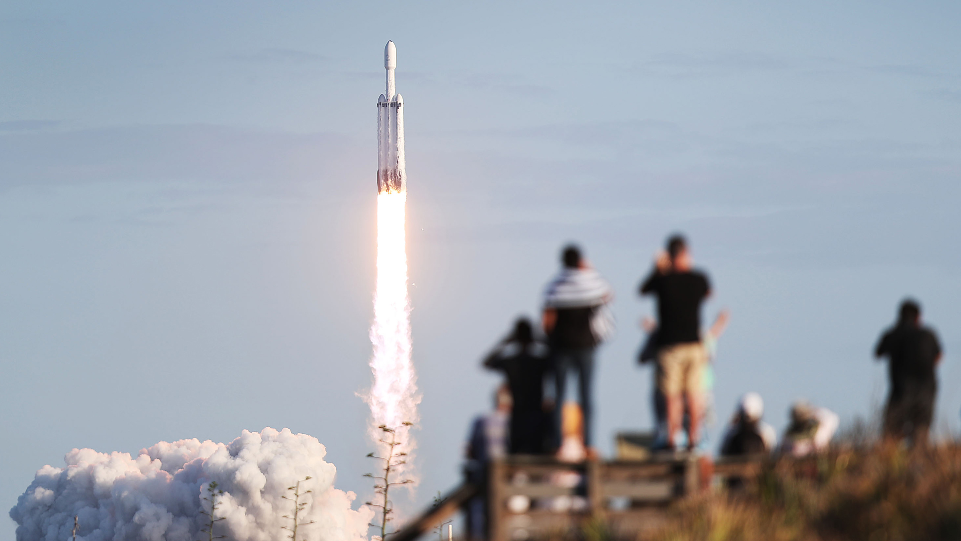 People watch as the SpaceX Falcon Heavy rocket lifts off from NASA's Kennedy Space Center on April 11, 2019, in Titusville, Florida. (Joe Raedle/Getty Images)