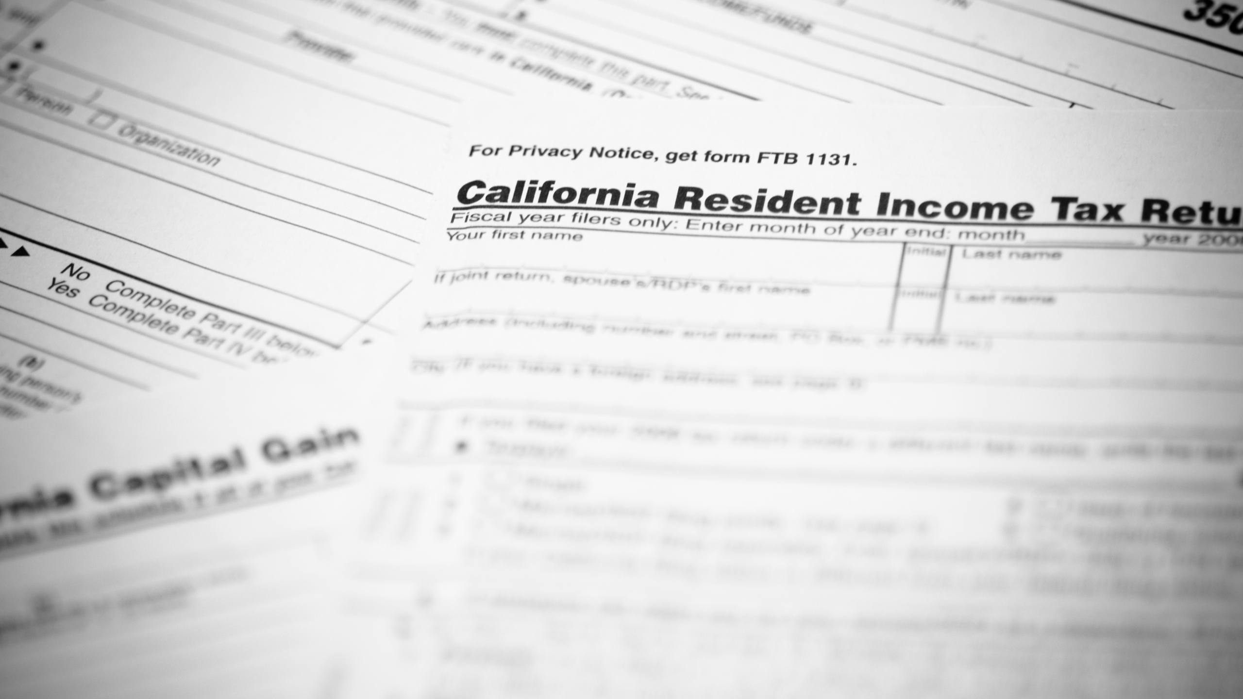 The California income tax form 540 with supplemental forms in the background in this file photo. (Credit: iStock / Getty Images Plus)