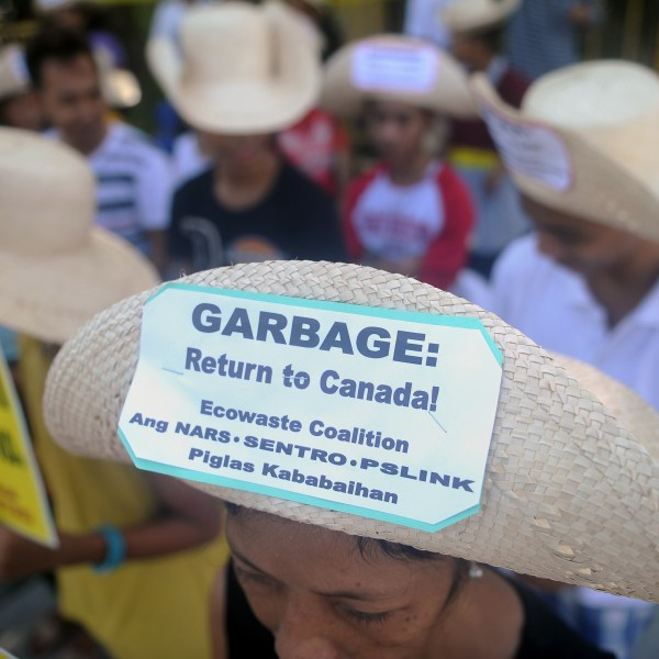 Environmental activists rally outside the Philippine Senate in Manila on September 9, 2015 to demand garbage be shipped back to Canada. (Credit: JAY DIRECTO/AFP/Getty Images)