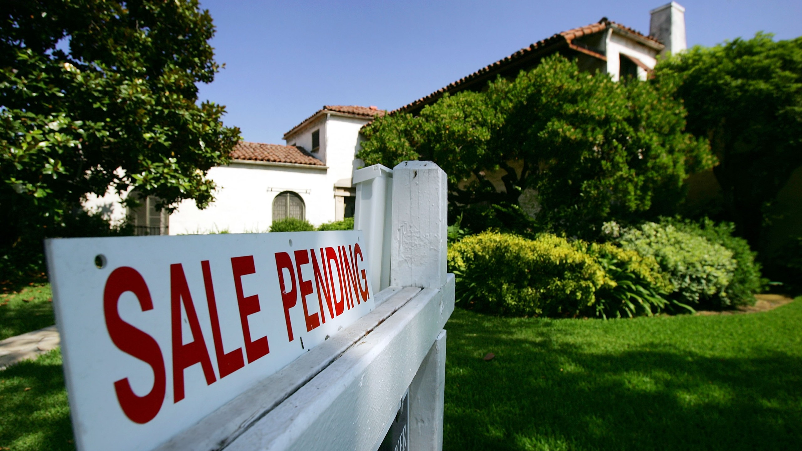 "A Pasadena house is seen with a ""For Sale"" sign in a file photo. (David McNew/Getty Images)"