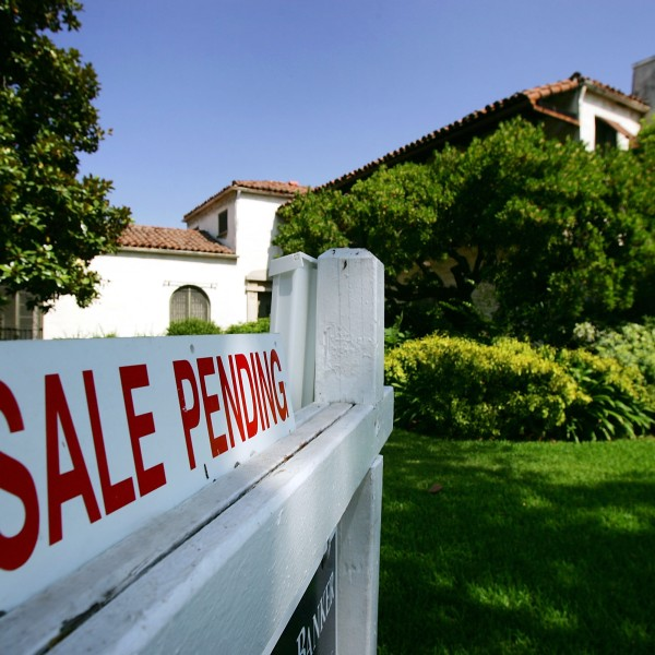 """A Pasadena house is seen with a """"For Sale"""" sign in a file photo. (David McNew/Getty Images)"""