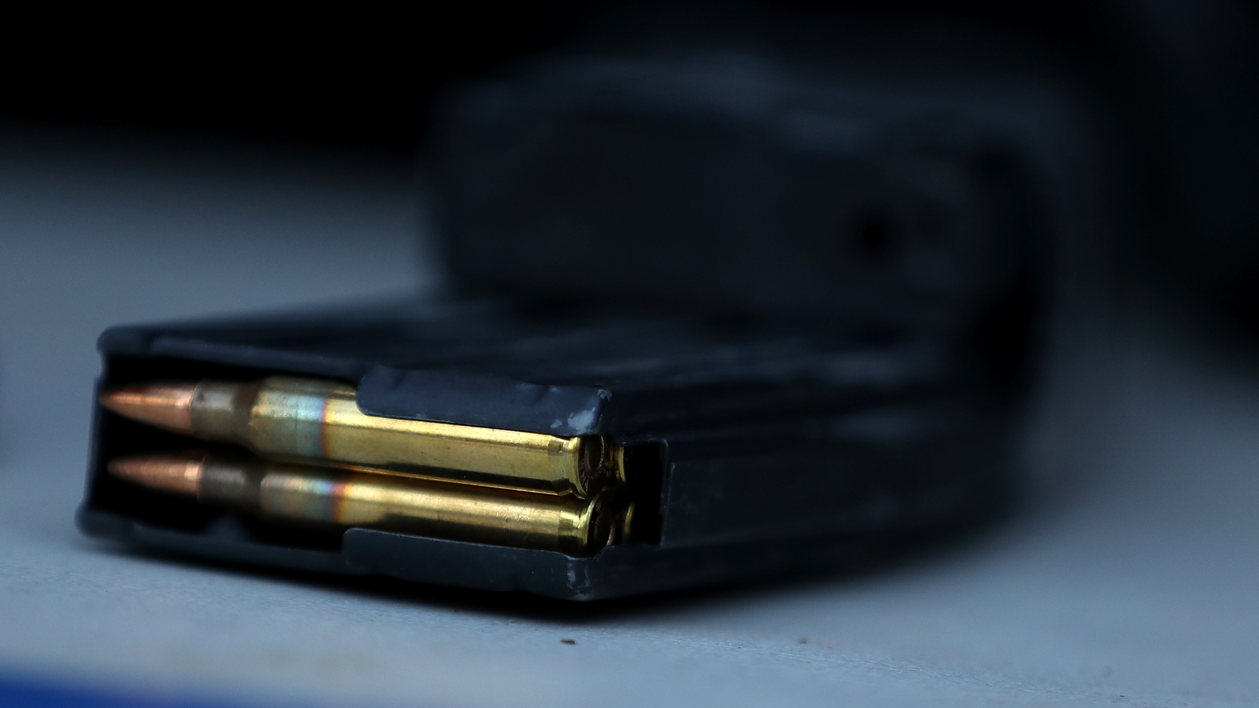 A surrendered assault rifle magazine with bullets sits on a table during a gun buyback event in San Francisco on Dec. 17, 2016. (Credit: Justin Sullivan / Getty Images)